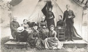The Alden family at Lake Chautauqua. Seated, left to right: Dr. Alden, Isabella Alden, Mrs. Christensen, Miss Julia Macdonald (Isabella's sister), Grace Livingston (Isabella's niece), Dr. Hannah Holland. Standing: Miss Williamson, Raymond Alden (Isabella's son).