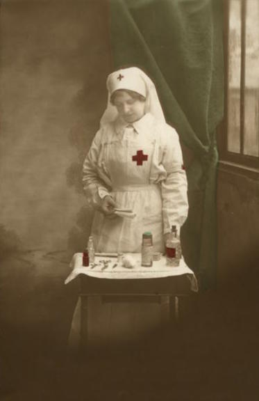 Nurse with medicine bottles