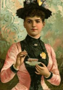 Woman holding tea cup and saucer