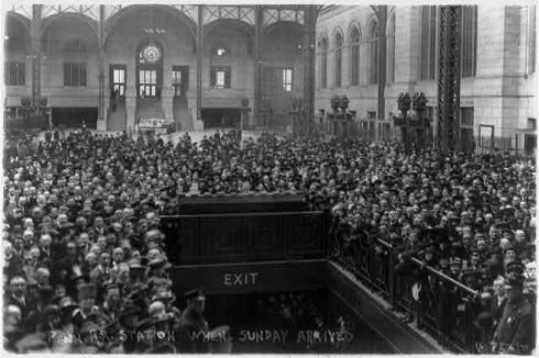 A crowd awaits Billy Sunday's arrival at Penn Station, New York City