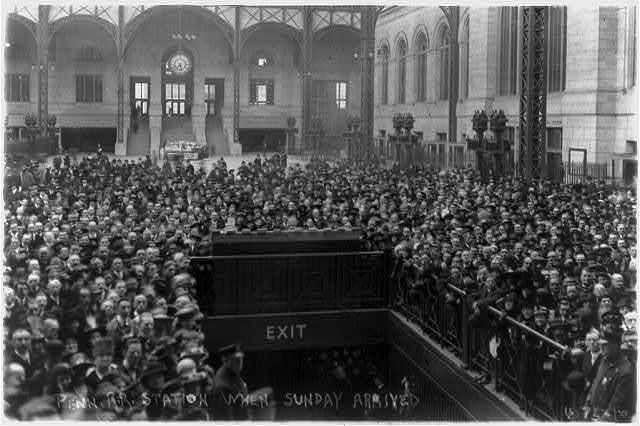 A crowd awaits Billy Sunday's arrival at Penn Station, New York City