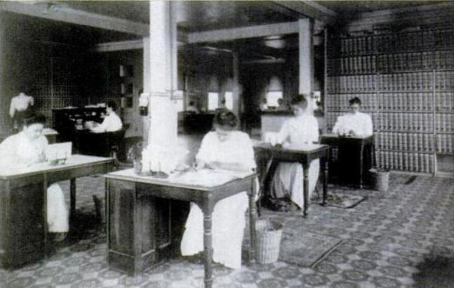 """Female employees answering mail. After the company was forced to admit Lydia Pinkham did not personally answer all letters, it used the revelation to its advantage, publishing this and other photos of its team of female employees answering mail. The company advertised: """"Every letter opened by a woman, seen only by a woman. No boys around."""""""