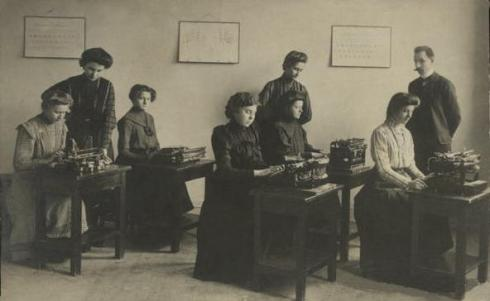Members of a typing pool with their male supervisor.