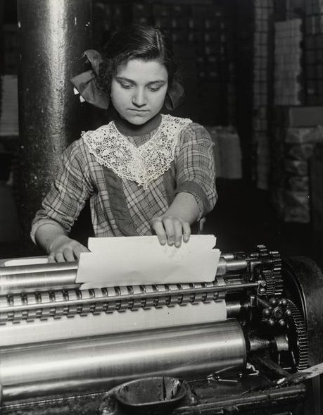 A 14-year-old girl at work in a paper box factory. From National Archives.