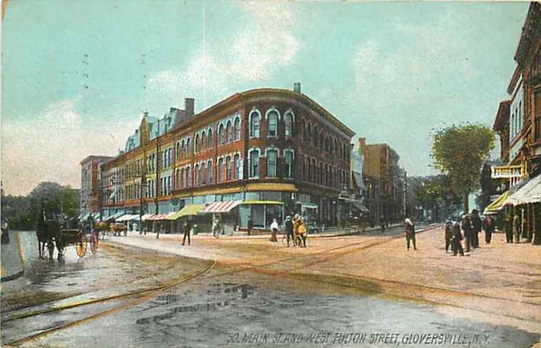 A 1908 postcard of Gloversville showing the intersection of Main Street, with its many retail glove shops, and Fulton Street where Isaac Macdonald's box factory was located.
