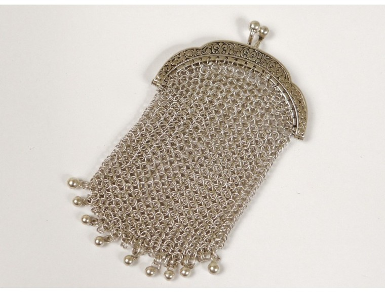 A sterling silver porte-monnaie. It's long shape suggests it was carried in a pocket.
