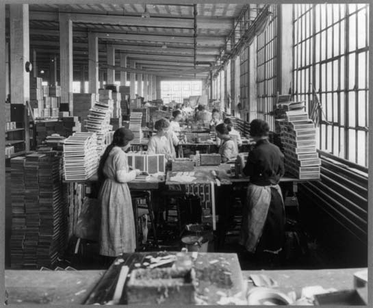 Women and girls working in a box factory, 1910.