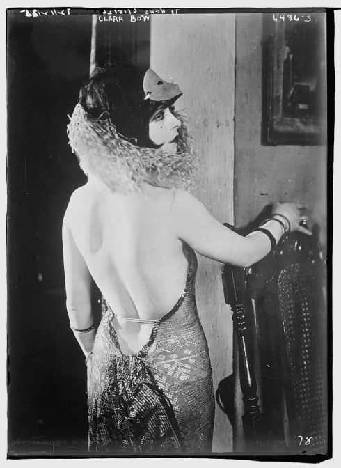 A 1922 photograph of actress Clara Bow in a daring backless dress. From the U.S. Library of Congress.