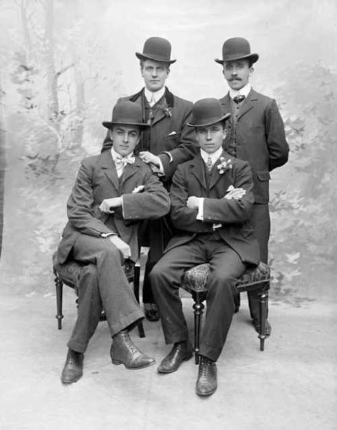 Dapper young men in bowler and derby hats-1910