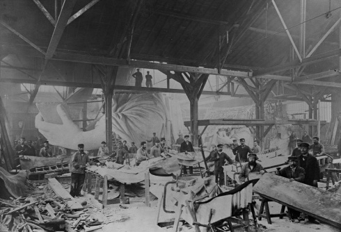 An 1882 photo of workmen constructing the Statue of Liberty in Bartholdi's Paris warehouse.