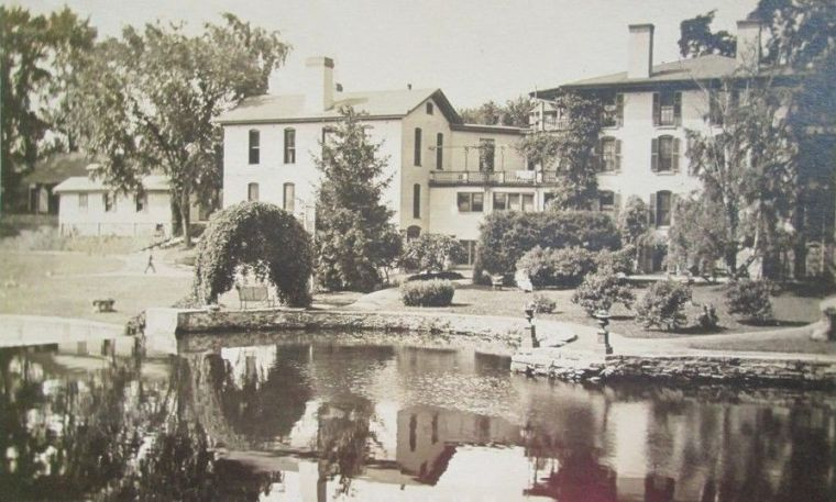 A view of the Sanitarium showing the pond and walking paths, about 1913.