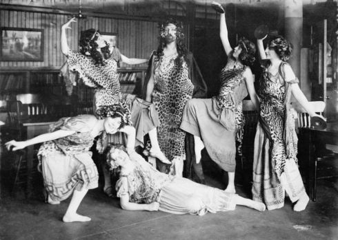 Society ladies and a gentleman perform as Bacchantes, 1909.