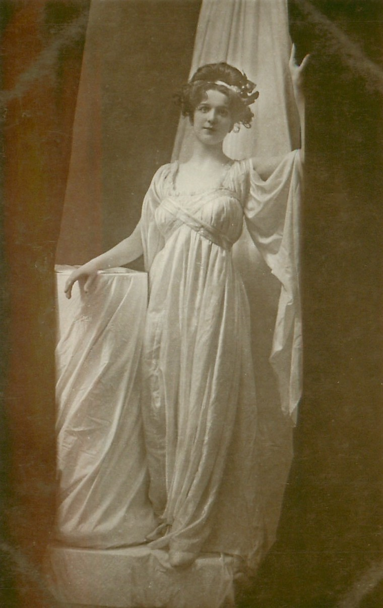 A woman in a classic Greek pose, 1903.