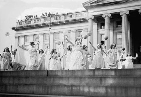 A tableau for women's suffrage on the front steps of the Treasury Building in Washington DC, 1913.