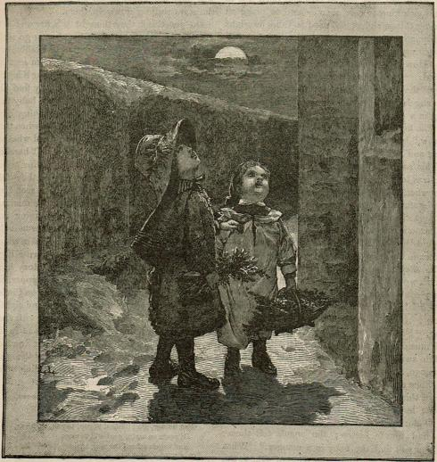 Two little girls dressed in coats and hats and carrying baskets stand outside a building. They are looking up as if singing to someone who is on an upper floor of the building.