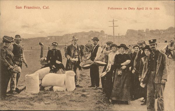 In an open field police officers and a group of people stand beside large white sacks of flour. One policeman holds a small bowl in which are white packets; beside him is a man holding out a large bowl to receive the packets. Other people in the photo are also holding out bowls. One woman and one man are holding small packets they have already received.