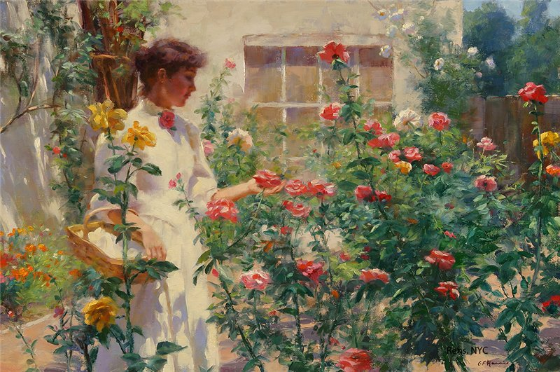 Painting of young woman dressed in white gown in style of 1910, standing amid a cluster of tall rose bushes of different colors. Over her arm she carries a basket. With her other hand she cups a pink rose.