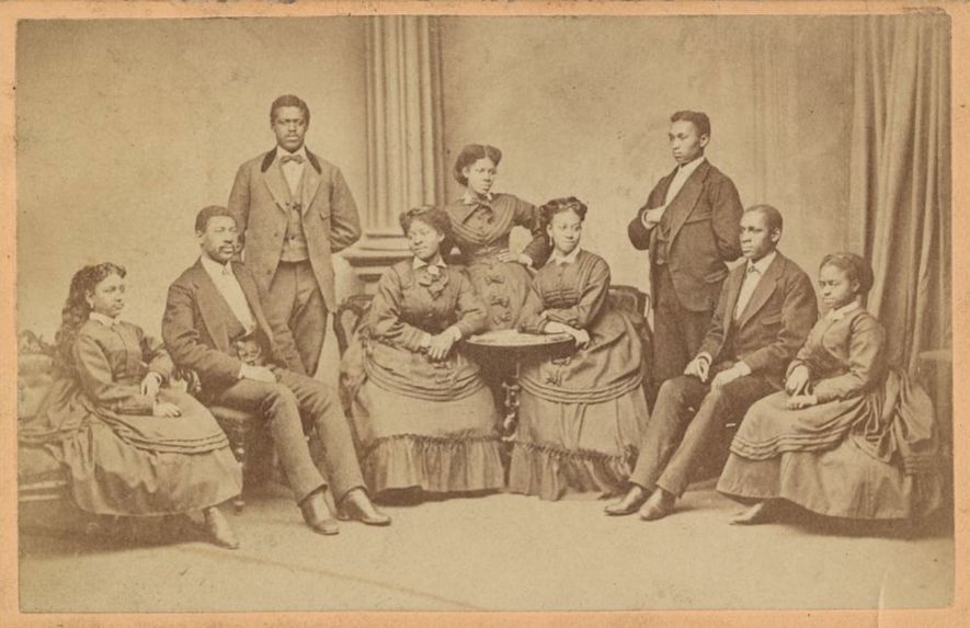 Photo of the Fisk Singers, five women and four men.