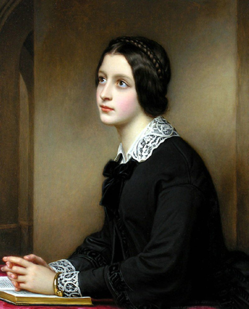 Young woman dressed in black with white lace collar and cuffs is seated at a table. A Bible is open on the table and her hands are clasped together on top of the open Bible.