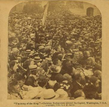 Sepia photo of a crowd of people packed tightly together.