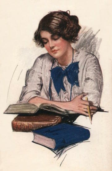 Young woman reads a thick book open on top of two other thick books. In her hand is a pencil.